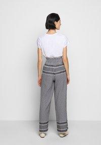 CECILIE copenhagen - BASIC TROUSERS - Trousers - black/white - 2