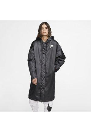 Waterproof jacket - black/muslin/white