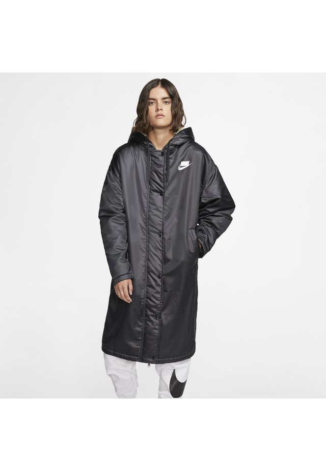 Waterproof jacket - black/muslin/white