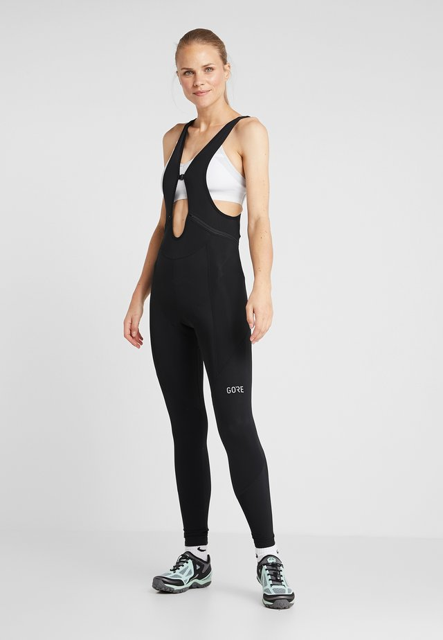 THERMO TRÄGERHOSE - Leggings - black
