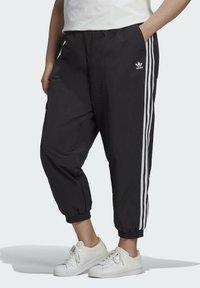 adidas Originals - Tracksuit bottoms - black - 0
