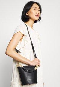 Vanessa Bruno - HOLLY MINI SEAU - Handbag - noir - 1