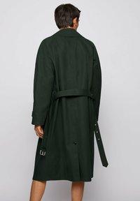 BOSS - ANDO RW - Trenchcoat - open green - 2