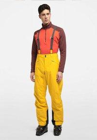 Haglöfs - LUMI LOOSE PANT - Snow pants - pumpkin yellow - 0