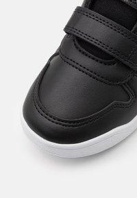 adidas Performance - TENSAUR UNISEX - Sportovní boty - core black/footwear white - 5