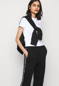 HUGO - NENNIFER - Pantalones deportivos - black - 3