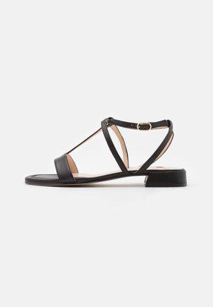 LIBELLA - Sandaalit nilkkaremmillä - schwarz