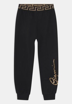 SIGNATURE UNISEX - Tracksuit bottoms - black/gold
