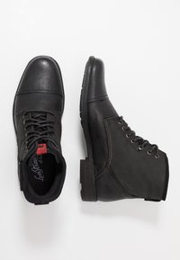 Levi's® - FOWLER - Lace-up ankle boots - regular black - 1