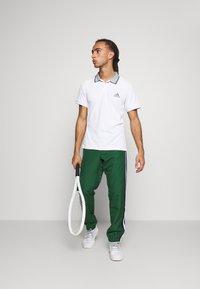 Lacoste Sport - Spodnie treningowe - green - 1