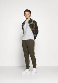 Champion Reverse Weave - CREWNECK BERLIN - Sweatshirt - mottled light grey - 1