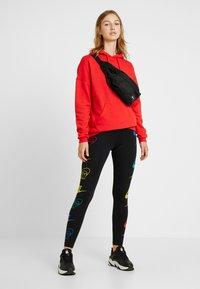 Nike Sportswear - LEGASEE FLIP - Leggings - black/racer blue - 1