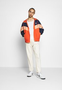 Nike Sportswear - Windbreaker - mantra orange/obsidian/orange frost - 1