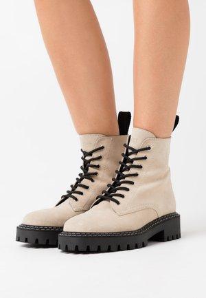 PAINT BOOT - Platform ankle boots - beige