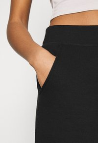 New Look - SLIM LEG JOGGER - Tracksuit bottoms - black - 4