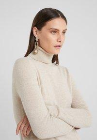 pure cashmere - TURTLE NECK DRESS - Jumper dress - oatmeal - 4