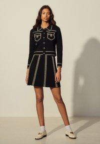 sandro - EUDINE - Mini skirt - noir - 0