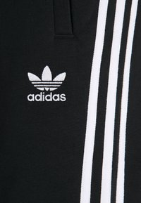 adidas Originals - STRIPES PANT - Tracksuit bottoms - black