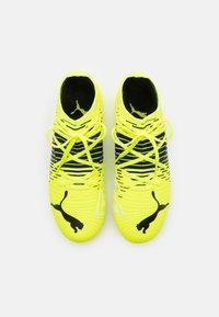 Puma - FUTURE Z 3.1 FG/AG JR UNISEX - Moulded stud football boots - yellow alert/black/white - 3