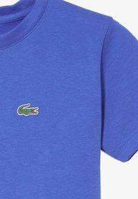 Lacoste Sport - LOGO UNISEX - Basic T-shirt - obscurity - 4