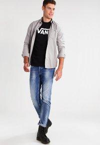 Vans - T-shirt print - black/white - 1