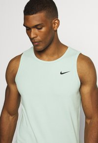 Nike Performance - DRY TANK SOLID - Sports shirt - pistachio frost - 4