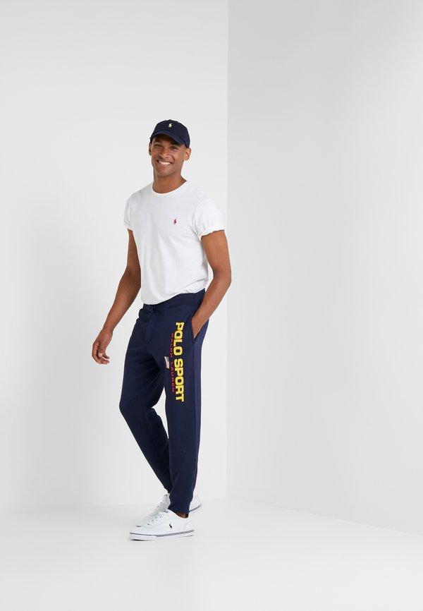 Polo Ralph Lauren Spodnie treningowe - cruise navy/granatowy Odzież Męska JFLA