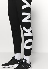 DKNY - EXPLODED LOGO CUFFED - Tracksuit bottoms - black - 3