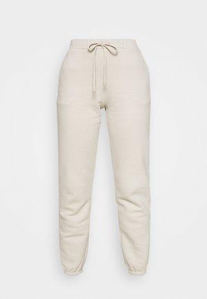 VISIVO - Tracksuit bottoms - beige
