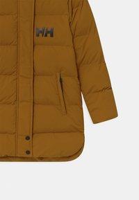 Helly Hansen - LUCA PUFFY UNISEX - Winter coat - spice - 3
