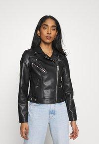 Vero Moda - VMHOPE COATED JACKET - Faux leather jacket - black - 0