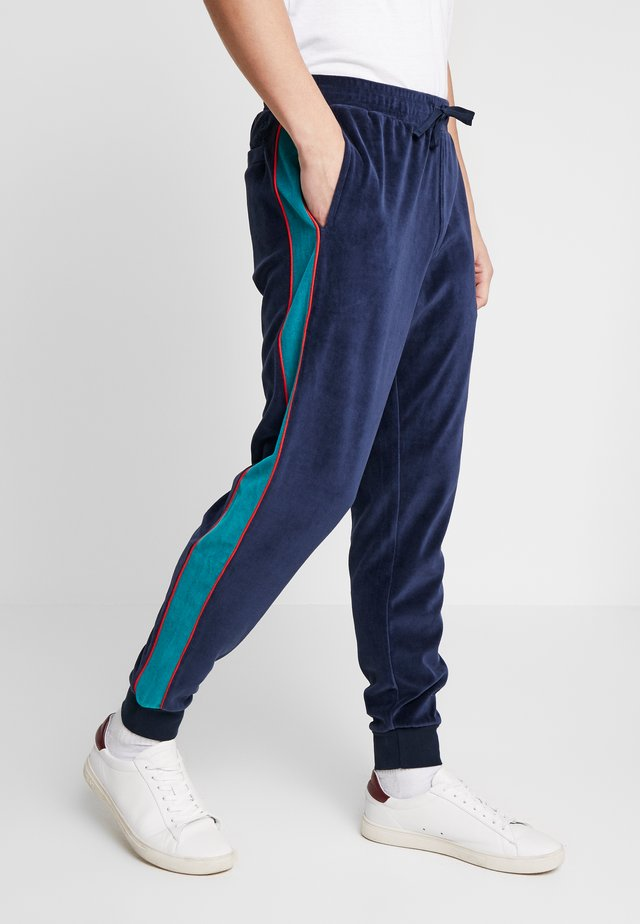 SIDE STRIPE TRACK PANT - Tracksuit bottoms - dark sapphire