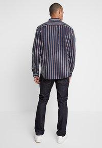 Nudie Jeans - GRIM TIM - Straight leg jeans - dry true navy - 2