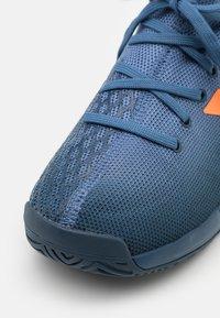 adidas Performance - JR UNISEX - Multicourt tennis shoes - crew navy/orange/crew blue - 5