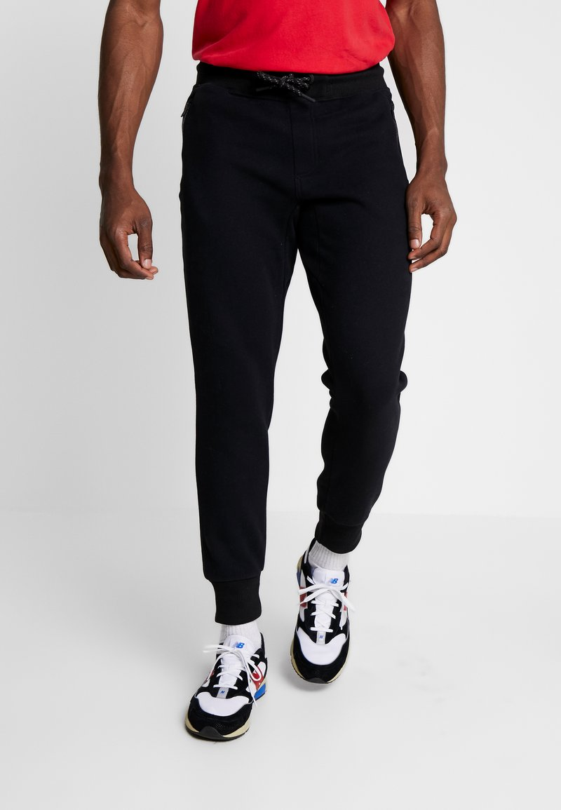 Superdry - COLLECTIVE - Tracksuit bottoms - black