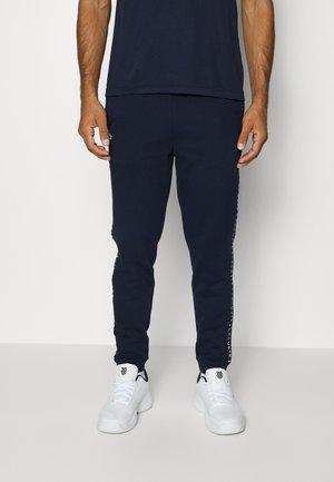 PANT TAPERED - Teplákové kalhoty - bleu marine
