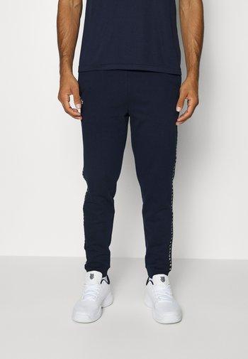 PANT TAPERED - Pantaloni sportivi - bleu marine