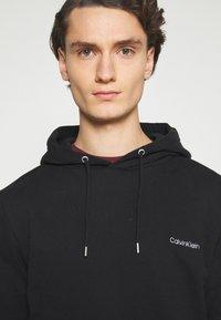 Calvin Klein - LOGO EMBROIDERY HOODIE - Hoodie - black - 4