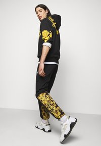Versace Jeans Couture - CRINKLE  - Tracksuit bottoms - black - 3