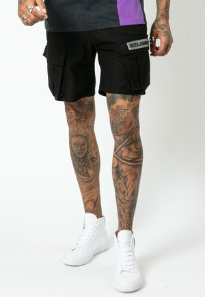 DAMAGE - Shorts - black