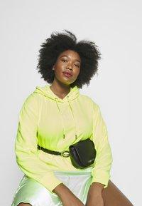 Calvin Klein - CHAIN BELT BAG - Bum bag - black - 1