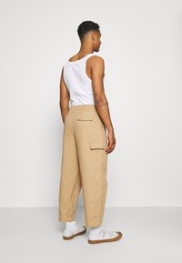 Vintage Supply - BAGGY CARPENTER TROUSERS - Trousers - sand - 2