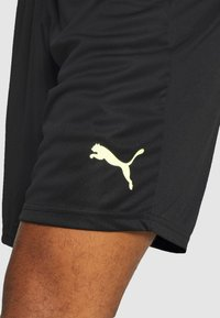 Puma - FTBLNXT SHORTS - Sports shorts - black/nrgy peach/fizzy yellow - 4