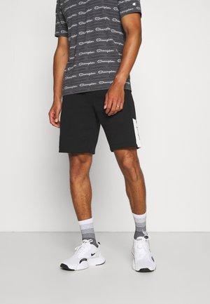BERMUDA - Sports shorts - black/white