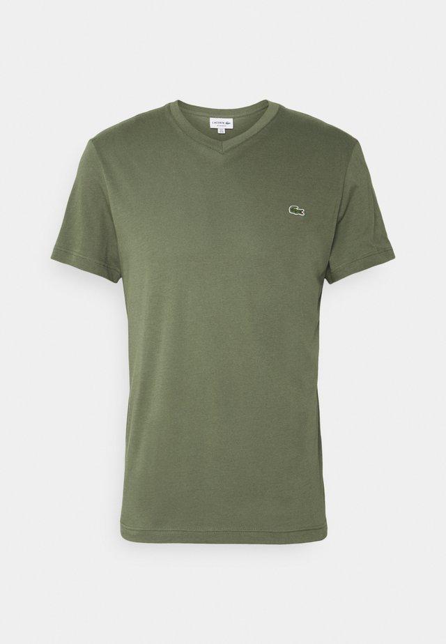 PLUS - T-shirt basique - tank