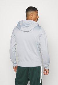 Nike Sportswear - REPEAT HOODIE - Long sleeved top - smoke grey/white - 2