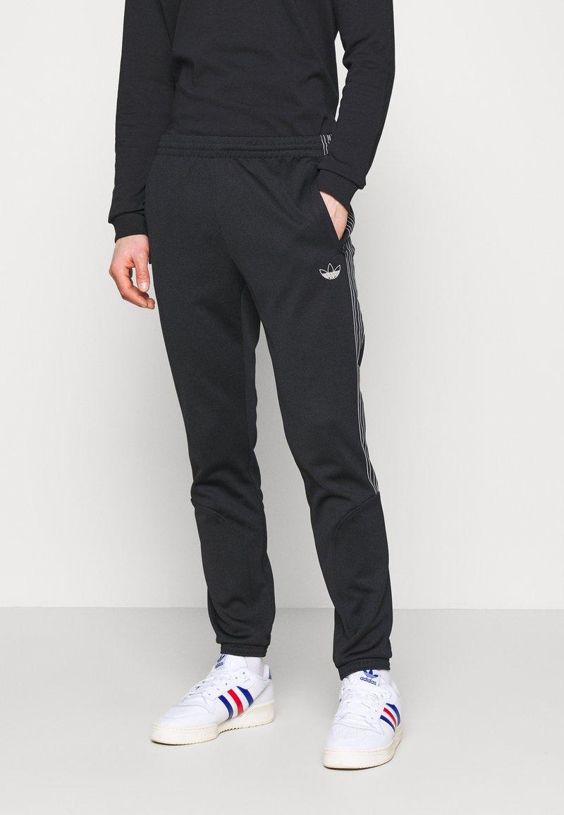 adidas Originals - Tracksuit bottoms - black