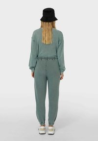 Stradivarius - Tracksuit bottoms - mottled teal - 2