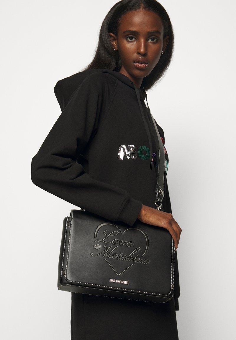 Love Moschino - BORSA  - Across body bag - black