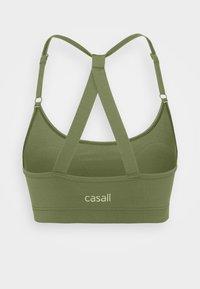 Casall - STRAPPY SPORTS BRA - Medium support sports bra - northern green - 1